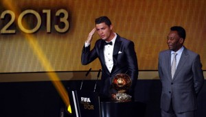 Portugal's Cristiano Ronaldo gestures beside Pele after being awarded the FIFA Ballon d'Or 2013 in Zurich