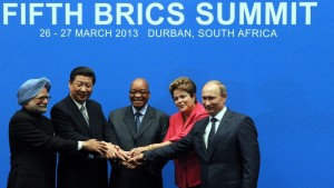 BRICS leaders (From L) India Prime minister Manmohan Singh, President of the People?s Republic of China Xi Jinping, South Africa's President Jacob Zuma, Brazil's President Dilma Rousseff and Russian Federation President Vladimir Putin, pose for a family photo in Durban on March 27, 2013. Leaders from the BRICS group of emerging powers failed to launch a much-anticipated new development bank to rival Western-dominated institutions like the World Bank.   AFP PHOTO / ALEXANDER JOE        (Photo credit should read ALEXANDER JOE/AFP/Getty Images)