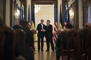 Ukraine's President Poreshenko shakes hands with U.S. Secretary of State Kerry after delivering a statement following a bilateral meeting in Kiev