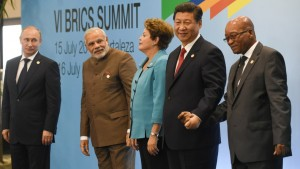 Russian President Vladimir Putin (L), Indian Prime Minister Narendra Modi (2nd-L), Brazilian President Dilma Rousseff (C), Chinese President Xi Jinping (2nd-R) and South African President Jacob Zuma pose for the photo session during the 6th BRICS Summit in Fortaleza, Brazil, on July 15, 2014. Leaders of the BRICS (Brazil, Russia, India, China and South Africa) group of emerging powers gathered in Brazil on Tuesday to launch a new development bank and a reserve fund seen as counterweights to Western-led financial institutions.  AFP PHOTO / YASUYOSHI CHIBA        (Photo credit should read YASUYOSHI CHIBA/AFP/Getty Images)