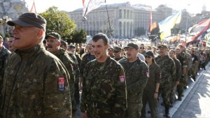 Members of the far-right radical group Right Sector, representatives of the Ukrainian volunteer corps and their supporters line up as they gather to march in central Kiev, Ukraine, July 3, 2015. The participants held a rally to demand from authorities to denounce the so-called Minsk peace agreements, to declare the military conflict in eastern Ukraine a war, to equip volunteer battalions by up-to-date standards and to break off diplomatic ties with Russia, according to local media. REUTERS/Valentyn Ogirenko  - RTX1IXCT