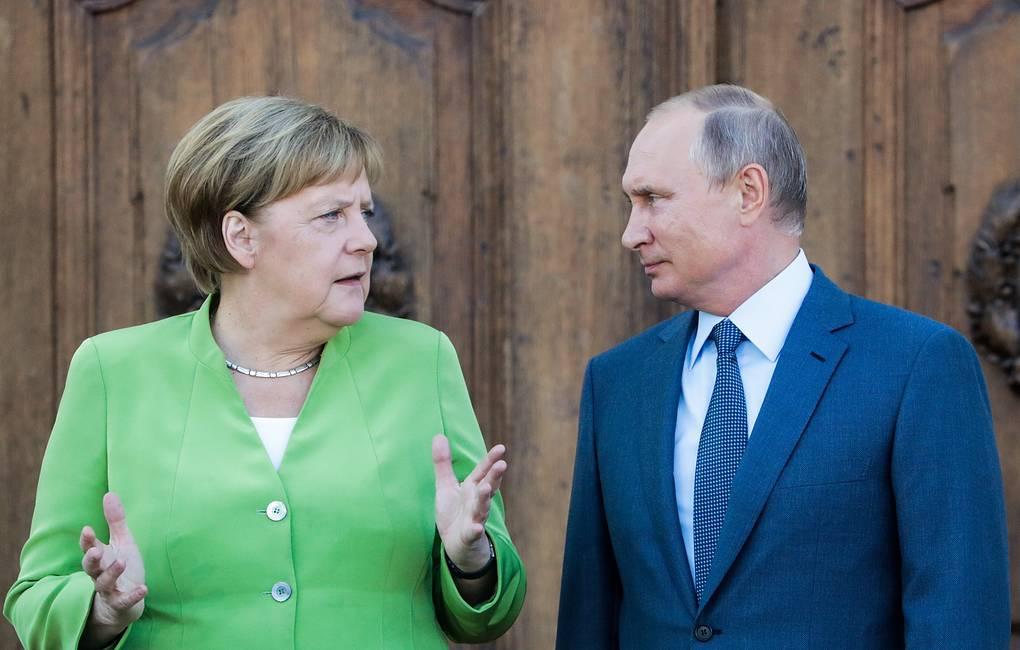 Путин и Меркель дали позитивную оценку состоявшемуся в Донбассе обмену удерживаемых лиц